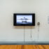 Josephine Meckseper, <i>0% Down </i>, 2008, digital video, 6 mins, black and white/sound, courtesy of the artist and Timothy Taylor, New York & London. Installation view of <i>Image Processors: Artists in the Medium – A Short History 1968–2020 </i>, Te Pātaka Toi Adam Art Gallery, Te Herenga Waka—Victoria University of Wellington, 2021. Photo by Ted Whitaker.